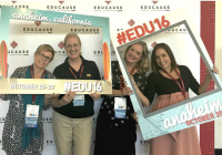 Four women at Educause 2016, holding photo frames and standing in front of conference backdrop.
