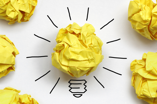 yellow crumpled paper light bulb