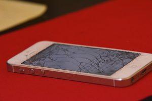 Broken iPhone on red background
