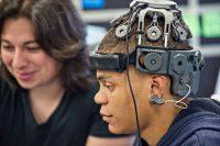 Side view of man wearing headgear with sensors.