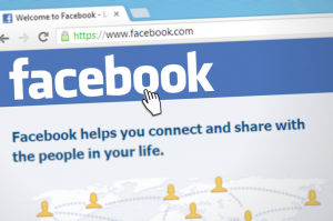 Screenshot of Facebook page with hand icon.