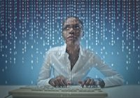 African American woman at computer, data stream overlay.