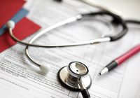 Medical records and stethoscope