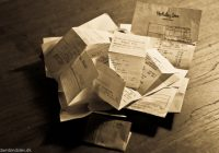 BW photo of pile of receipts and bills.