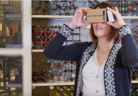 Professor Joanna Millunchick standing in her lab demonstrating VR glasses.