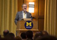 photo of President Schlissel standing at podium.