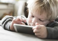 Toddler boy using smartphone