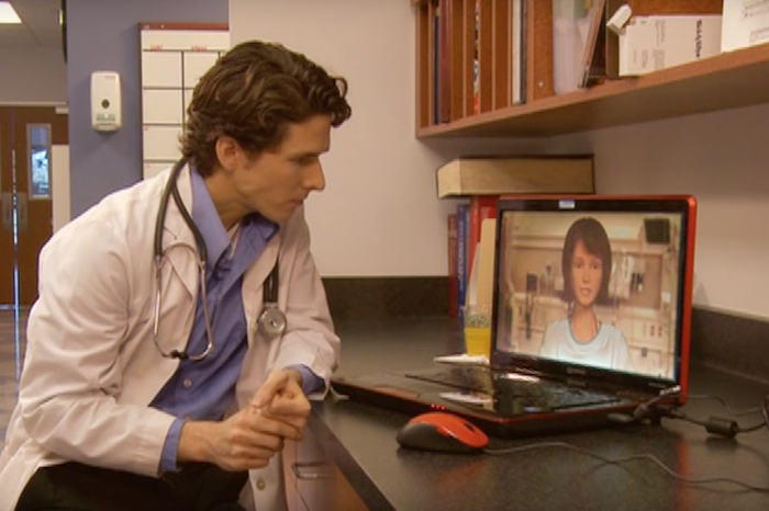 Male doctor interacting with virtual patient.