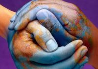 hands painted with illustration of globe