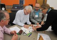 "Members participate in a collaborative ""Wonder Book"" activity"