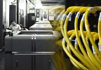 BW historical image of computer room blended with color image of yellow ethernet cables.