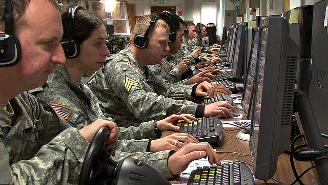 U.S, army personnel at computer stations