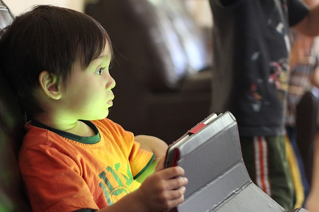 young boy holding tablet