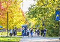fall campus with walking students