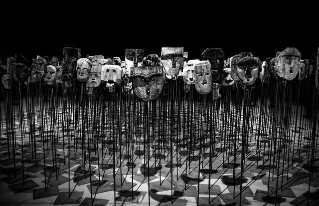 dozens of masks on sticks