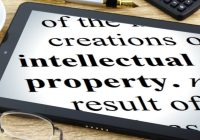 """ipad with the words """"intellectual property"""" on the screen"""