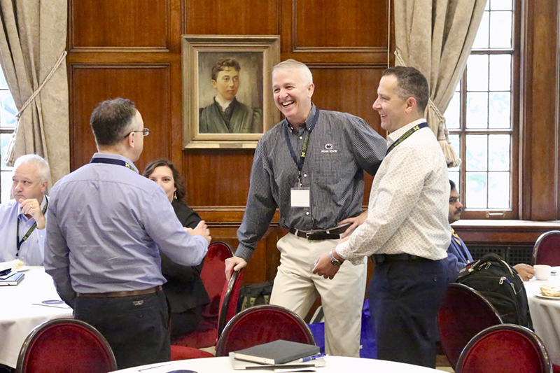 A group of IT leaders chat during a break at the Great Lakes IT Leadership Forum.