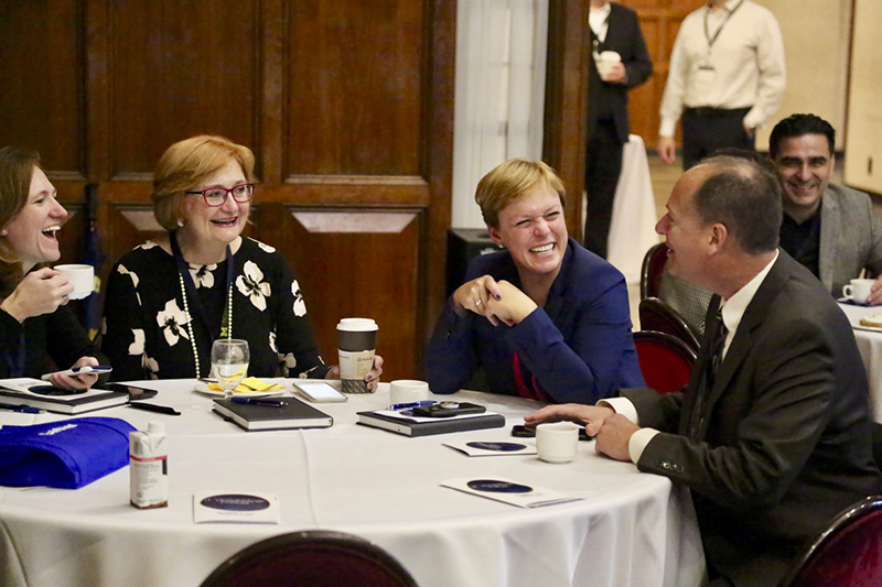 IT leaders chat around a table at the Great Lakes IT Leadership Forum.