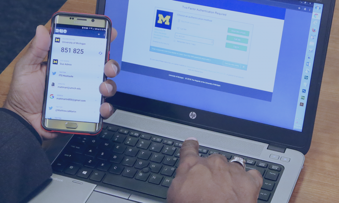 A person uses the Duo Mobile App to authenticate with U-M Weblogin