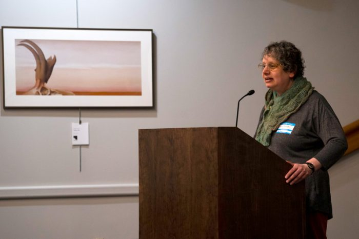 Jane Berliss-Vincent speaks at the podium at World IA Day 2019 in Ann Arbor
