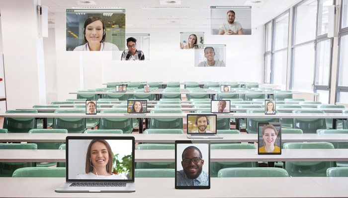 classroom with student faces displayed on various devices