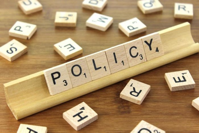 "the word ""policy"" spelled out in scrabble letters"