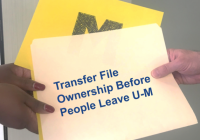 file being handed between two peopls