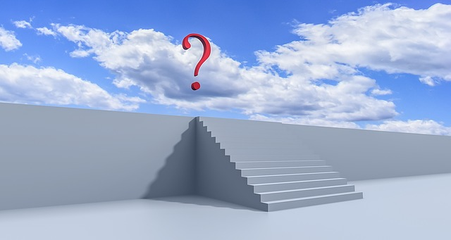 stairs with a floating question mark in a blue sky with clouds