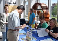 attendees registering for event