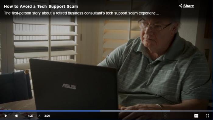 older man sitting at computer
