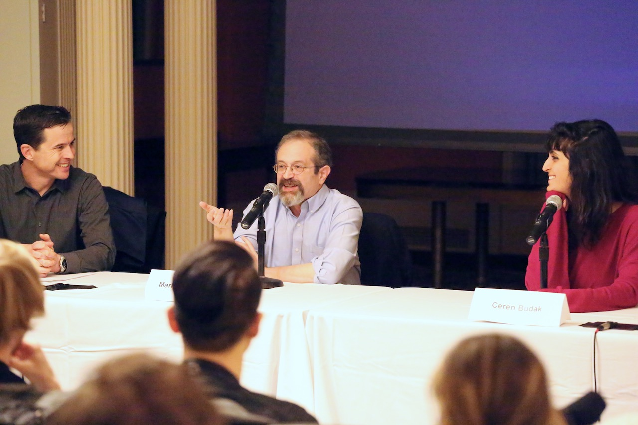 Brendan Nyhan, Mark Ackerman, and Ceren Budak speaking on a panel at a Dissonance event.