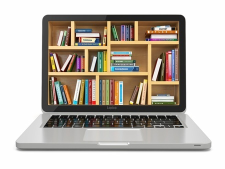 laptop with images of books on the screen