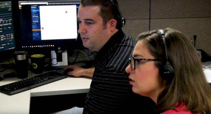 An ITS staff member shadows a Service Center associate during a RideAlong session.
