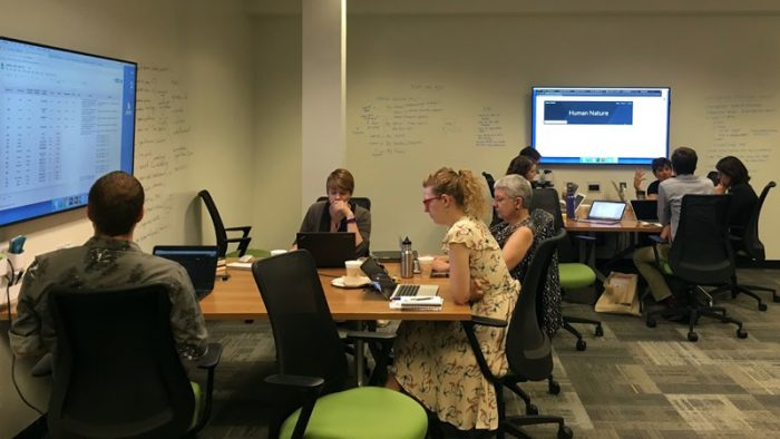 Two teams from Scholar Sprints Summer 2018 working in ScholarSpace (206 Hatcher Graduate Library)