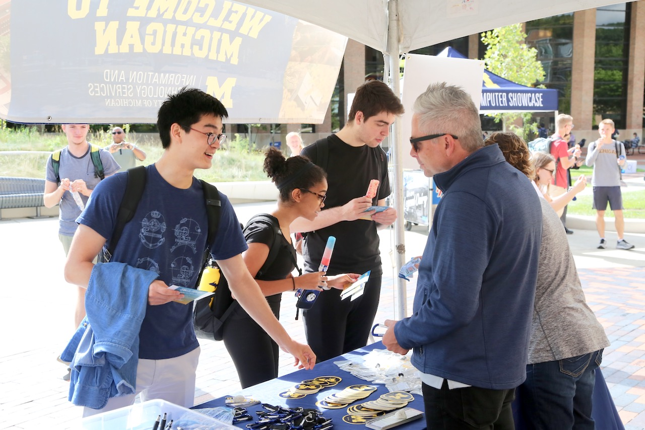 Students picked up information on ITS from a Welcome to Michigan display.