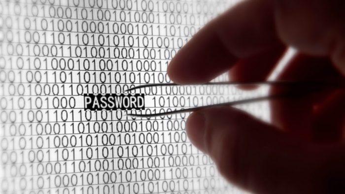 "hand holding tweezers selecting ""password"" from data screen"