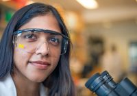 Researcher with U-M branded eye protection