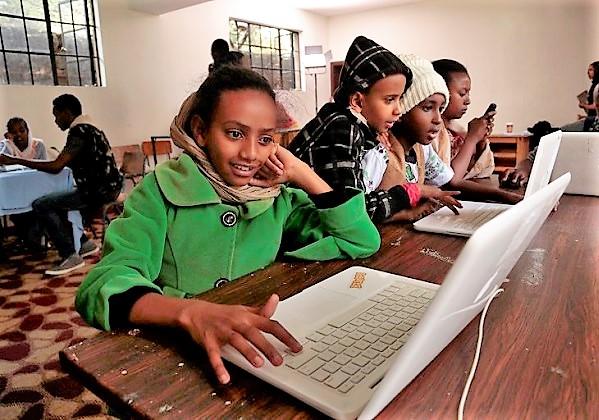 Schoolchildren in Nairobi working on computers