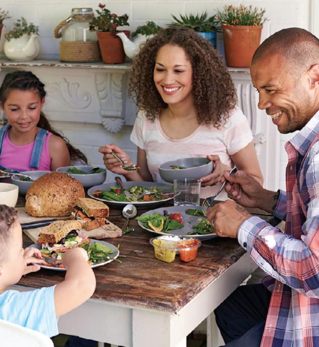Black family sitting around dinner table
