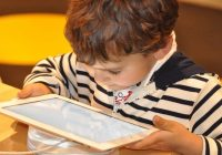 little boy using a tablet computer