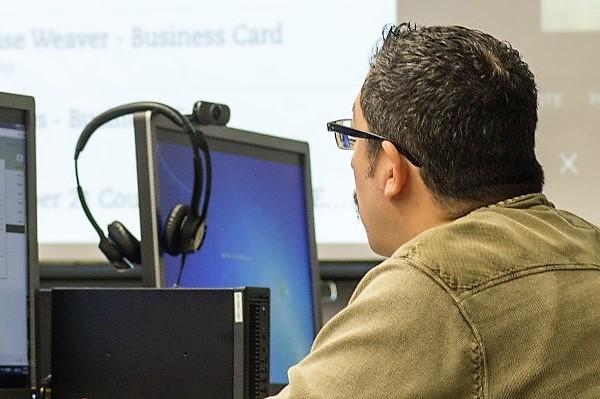 Man sitting at computer.
