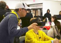 Instructor helping student using VR technology