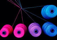 (Five spools of yarn — two pink, one purple, two blue — each with a string of yarn extended out, tied to the others.)