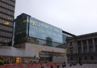 Photo of a large, glass Microsoft building.