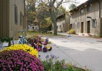 Exterior of Northwood 4 apartments with flowers and bicycles in the foreground.