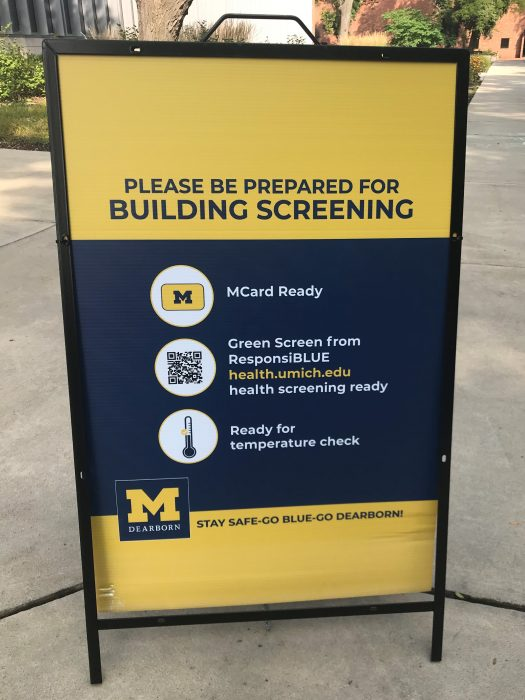 Signboard with building screening instructions