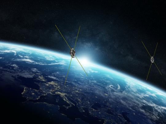 rendering of Swarm satellites in space