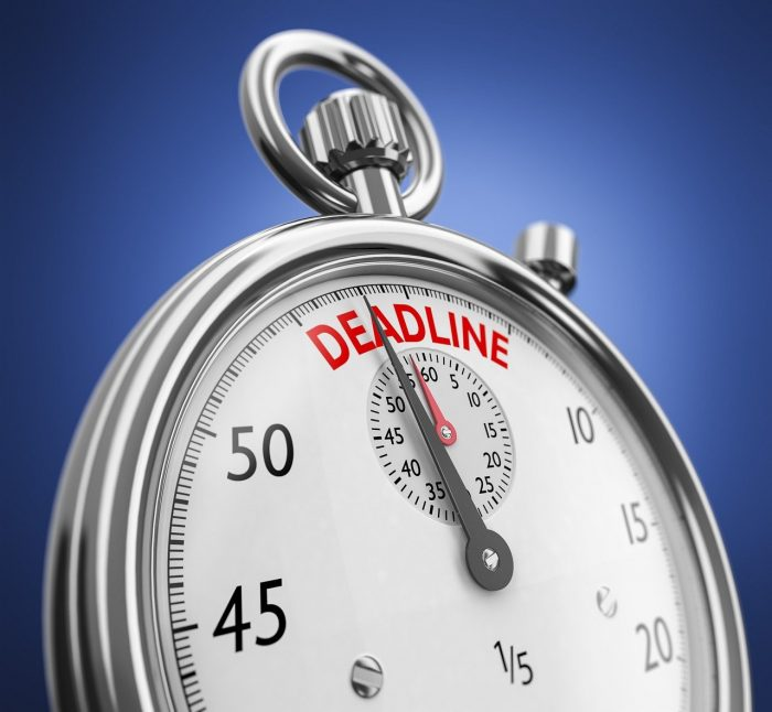 """A stopwatch with the word """"deadline"""" at the top of the dial."""