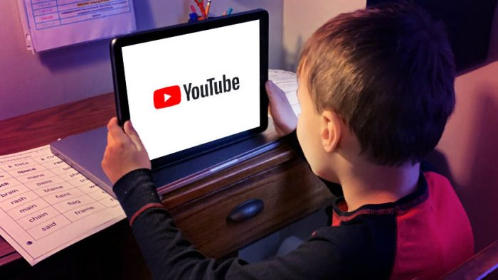 young boy watching YouTube on a tablet