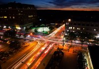 Aerial nighttime timelapse view of traffic in Ann Arbor downtown intersection.